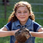 Girl holding duck