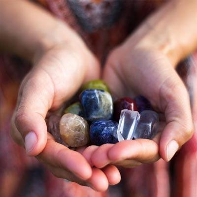polished rocks in hands